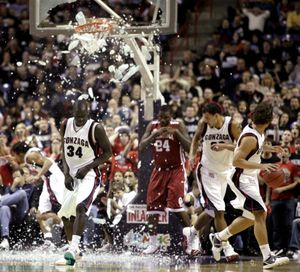 Gonzaga's Bol Kong (34) gets out of the way after a dunk by Oklahoma's Tiny Gallon (24) shattered the backboard during the second half of an NCAA college basketball game in Spokane, Wash., Thursday, Dec. 31, 2009. (Rajah Bose / Fr120940 Ap)