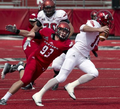 Eastern Washington quarterback Gage Gubrud, right, has the ability to hurt opponents with his feet, head coach Beau Baldwin said. (Dan Pelle / The Spokesman-Review)