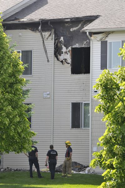 This building at the Big Trout Lodge apartments in Liberty Lake, Wash. was heavily damaged Thursday, June 14, 2012, when it caught fire.  Fire investigators have confirmed that the fire was arson. (Jesse Tinsley / The Spokesman-Review)