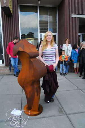 Lily Neal  stands beside the figure she posed for when she was nine months pregnant. Associated Press photos (Associated Press photos / The Spokesman-Review)