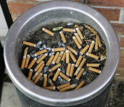 An ashtray full of cigarette butts is shown in Omaha, Neb., in this March 28, 2007 file photo. (Nati Harnik / Associated Press)