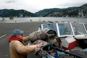 Bob Shelton of Spokane ties down his boat Tuesday after fishing Wolf Lodge Bay on Lake Coeur d'Alene. Idaho Health and Welfare advisories say anglers should limit the amount of fish they eat from lakes.  (Jesse Tinsley / The Spokesman-Review)