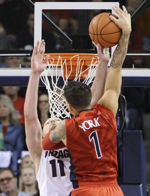 Gonzaga forward Domantas Sabonis (11) blocks Arizona guard Gabe York's (1) shot during a college basketball game on Saturday, Dec. 5, 2015, at McCarthey Athletic Center in Spokane, Wash. Arizona won the game 68-63. (Tyler Tjomsland / The Spokesman-Review)