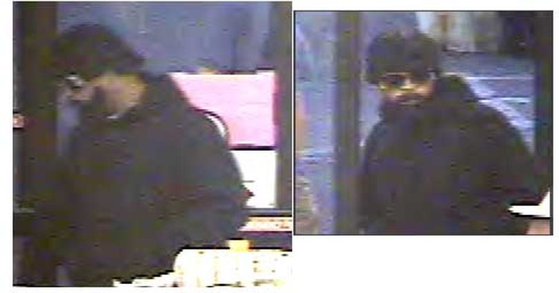 Surveillance camera images of a man who robbed the Grocery Outlet on North Division Street in Spokane on Tuesday, June 23, 2009. (Courtesy of Spokane Police Department)