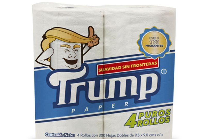 "This illustration released by Antonio Battaglia shows toilet paper wrapped in mock-up packaging, featuring a cartoon image in the likeness of President Donald Trump, with the Spanish phrases ""Softness without borders,"" center, ""This supports migrants,"" top right, ""Four pure rolls,"" bottom right, which is a play on words in Spanish that roughly translates as ""Pure nonsense."" (Antonio Battaglia / Associated Press)"