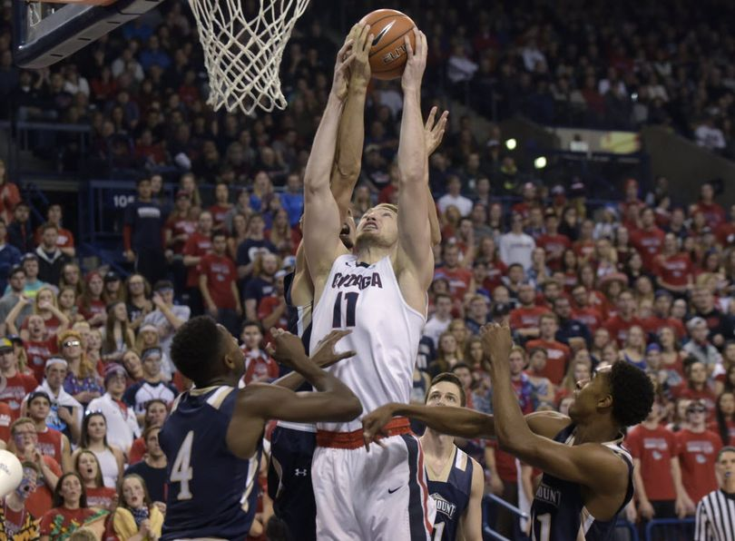 Gonzaga's Domantas Sabonis (11) tries to pull down a rebound between Mount St. Mary's players, including Khalid Nwandu (4), during the first half of an NCAA college basketball game, Saturday, Nov. 21, 2015, in Spokane, Wash. The Bulldogs resume their cross-state rivalry with Washington this morning in their first of three games at the Battle 4 Atlantis in the Bahamas. (AP Photo/Rajah Bose)