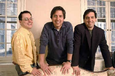 Actor Ray Romano, center, poses with brothers Robert, left, and Richard.  (Associated Press / The Spokesman-Review)