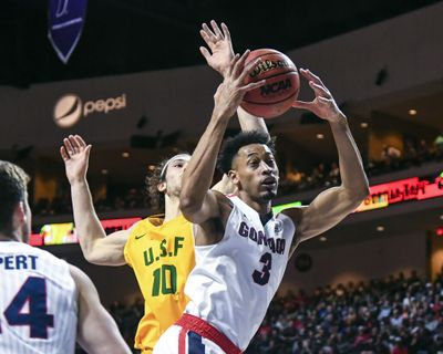 Gonzaga forward Johnathan Williams snags a rebound against San Francisco forward Matt McCarthy, Monday, March 5, 2018, during the West Coast Conference Tournament at the Orleans Arena in Las Vegas.  (DAN PELLE/The Spokesman-Review)