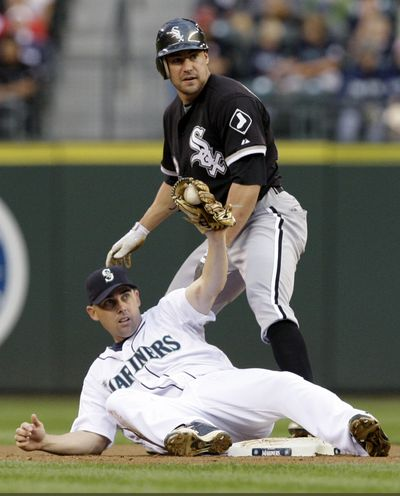 Jack Wilson, bottom, forces out Scott Podsednik but is injured on play in third. (Associated Press / The Spokesman-Review)