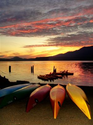 Sunset over Lake Quinault and the boating beach at Quinault Lodge.
