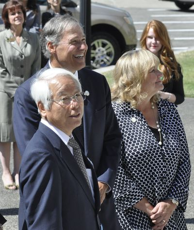 Gov. Jay Inslee and his wife, Trudi, watch as Hyogo Gov. Toshizo Ido addresses a crowd gathered for ceremonies to honor the sister-state relationship. (Jim Camden)
