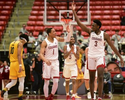 Washington State guard Jervae Robinson (1) and forward Robert Franks (3) celebrate after California coach Wyking Jones called a timeout during the second half of an NCAA college basketball game Thursday, Jan. 17, 2019, in Pullman, Wash. Washington State won 82-59. (Pete Caster / AP)