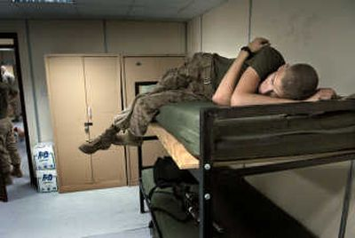 Life on the sidelines: Disappointment and boredom settle in after Shipp and his platoon learn they will be headed back to the USS Germantown instead of moving north and marching into Iraq.  (The Spokesman-Review)
