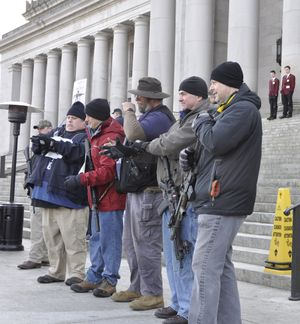 OLYMPIA -- Gun rights supporters, most of them openly carrying their weapons, gather on the steps of the Capitol Building for a rally on Jan. 13, 2017 (Jim Camden/The Spokesman-Review)