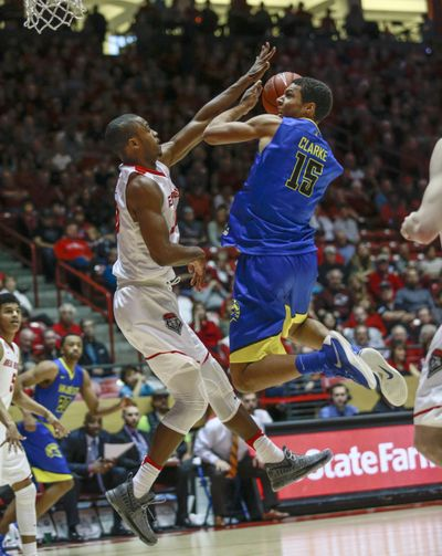 San Jose State's Brandon Clarke (15) shoots over New Mexico's Sam Logwood during the second half of an NCAA college basketball game in Albuquerque, N.M., Saturday, Feb. 4, 2017. San Jose State won 78-68. (Juan Antonio Labreche / Associated Press)