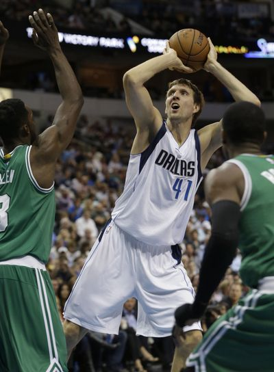 Mavericks forward Dirk Nowitzki finished with 27 points on 9-of-14 shooting and made all four of his 3-point attempts in Dallas win. (Associated Press)