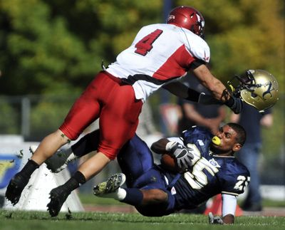 Northern Colorado's Jace Davis, right, has his helmet knocked off in a collision with Eastern Washington's J.C. Sherritt on Oct. 16, 2010, at Nottingham Field in Greeley, Colo.  (Eric Bellamy)
