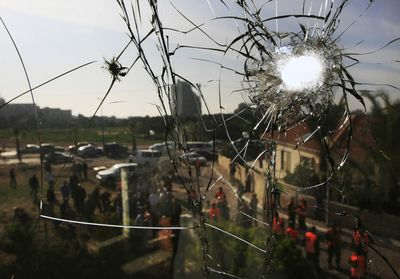 A shattered window is seen after a rocket fired by Palestinian militants in Gaza hit the southern Israeli city of Ashkelon on Monday. Israel seized control of high-rise buildings and attacked houses, mosques and tunnels as it pressed forward with its offensive against the Gaza Strip's Hamas rulers.  (Associated Press / The Spokesman-Review)