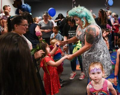 Ruby Heath, left, dances with drag queen Tirrany Hex, right, and other children at the conclusion of Drag Queen Story Hour on Saturday, June 15, 2019, at the South Hill Library in Spokane, Wash. (Tyler Tjomsland / The Spokesman-Review)