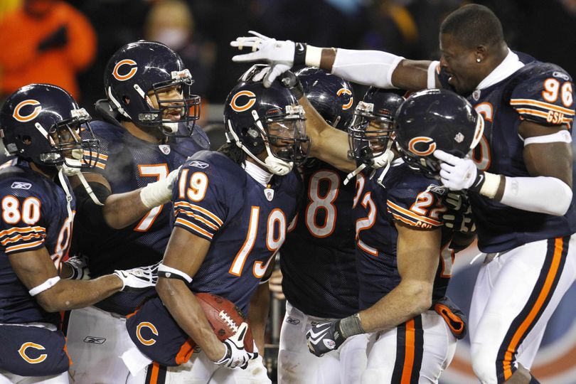 Associated Press Bears WR Devin Aromashodu is mobbed after his game-winning TD. (Associated Press)