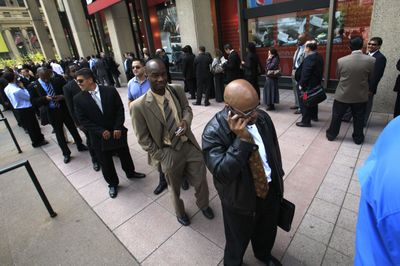 Job seekers line up outside Madison Square Garden for a job fair in New York in mid-May.  (Associated Press / The Spokesman-Review)