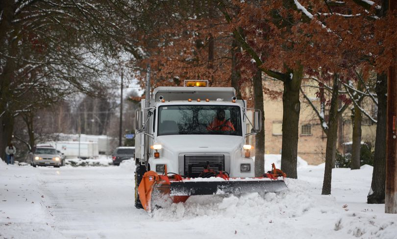 A plow removes snow from East Dalton Avenue in Millwood Dec. 27, 2016, after overnight snows of 2 to 4 inches around the Spokane region. (Jesse Tinsley / The Spokesman-Review)