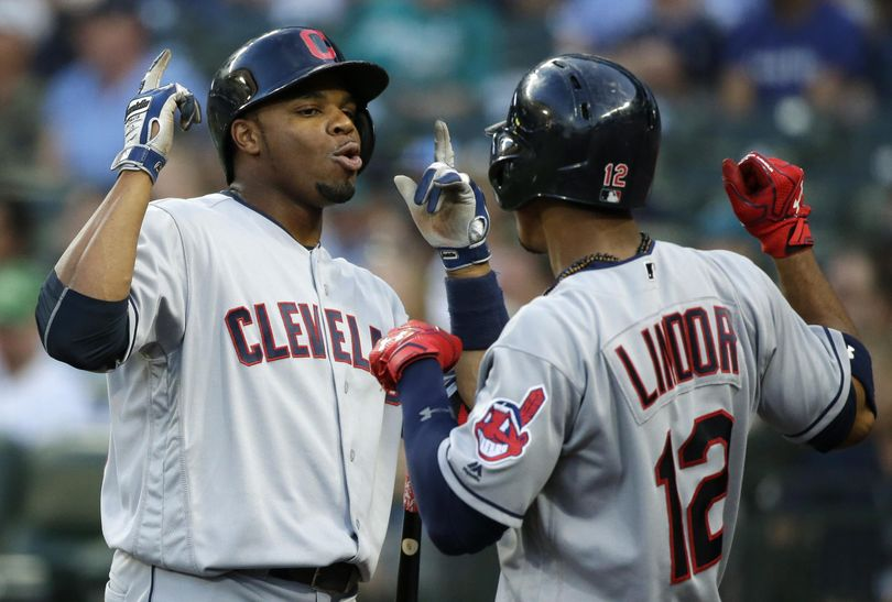 Cleveland's Rajai Davis, left, celebrates his fifth-inning solo home run with teammate Francisco Lindor. (Ted S. Warren / Associated Press)