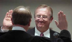 Ralph Baker takes the oath of office for Spokane County assessor on Tuesday afternoon, replacing Duane Sommers.   (Christopher Anderson/ / The Spokesman-Review)