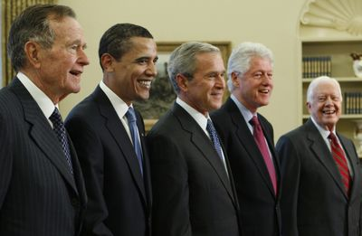 George H.W. Bush, Barack Obama, George W. Bush, Bill Clinton and Jimmy Carter pose  in the Oval Office of the White House on Wednesday.  (Associated Press / The Spokesman-Review)