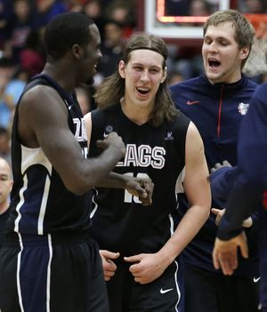 """Fans chanted """"Get a haircut"""" at Kelly Olynyk. Instead he cut down the Broncos with a career-high 33 points. (Associated Press)"""