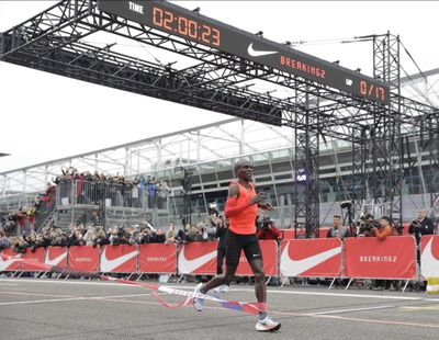 Olympic marathon champion Eliud Kipchoge crosses the finish line of a marathon race at the Monza Formula One racetrack, Italy, Saturday, May 6, 2017. Kipchoge was 26 seconds from making history on Saturday but in the end the Olympic champion was just short of becoming the first person to run a marathon in less than two hours. Kipchoge ran the 26.2 miles (42.2 kilometers) in 2 hours and 25 seconds, beating Dennis Kimetto's world record of 2:02:57, but the Kenyan failed to run the first sub-two hour marathon. (Luca Bruno / Associated Press)