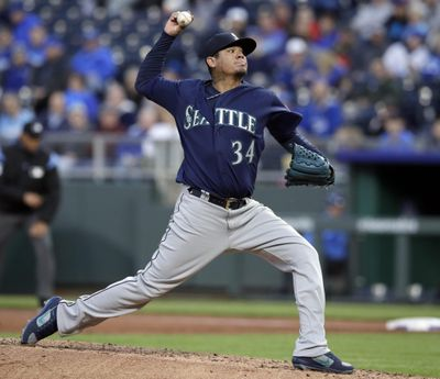 Seattle starting pitcher Felix Hernandez delivers to a Kansas City Royals batter during the first inning Tuesday  in Kansas City, Missouri. (Orlin Wagner / AP)