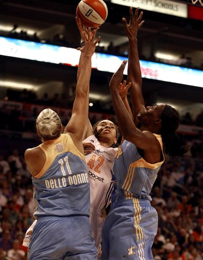 Phoenix's Brittney Griner shoots over Chicago's Elena Delle Donne and Sylvia Fowles. (Associated Press)