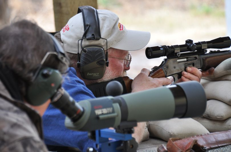 A shooter checks his hunting rifle at the Spokane Rifle Club with help from a club member during the annual fall Sight-in Days. (Rich Landers)