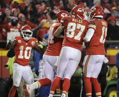 Kansas City Chiefs quarterback Alex Smith (11) and tight end Travis Kelce (87) celebrate with tight end Demetrius Harris (84) after Harris caught a pass for a two-point conversion during the second half of an NFL divisional playoff football game against the Pittsburgh Steelers Sunday, Jan. 15, 2017, in Kansas City, Mo. The play, that would have tied the game, was called back on a holding penalty. (Charlie Riedel / Associated Press)