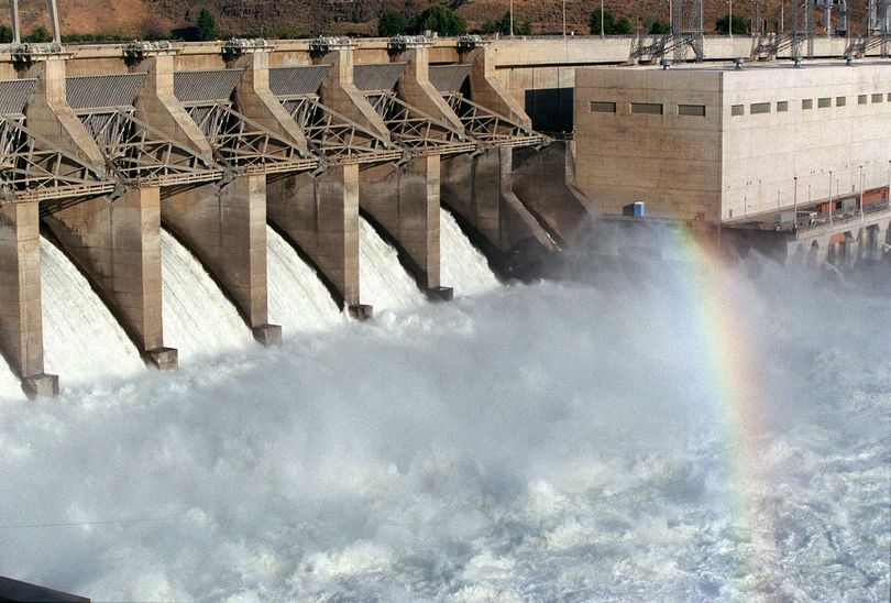 A rainbow shines in the cascading water at Ice Harbor Dam on the Snake River. (File / The Spokesman-Review)