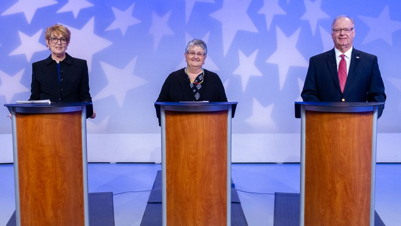 From left, Julie Ellsworth, Vicky McIntyre, and Tom Kealey debate during the