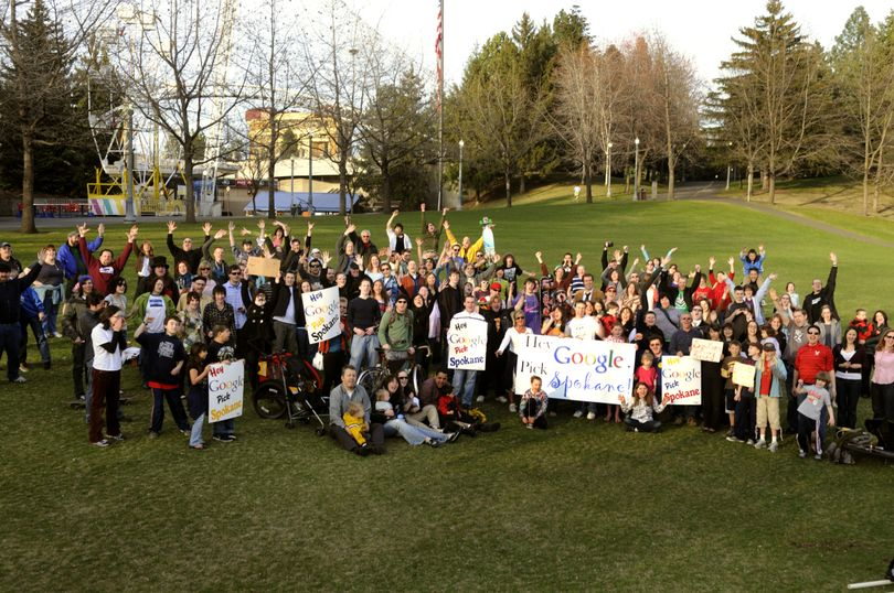 """The """"Hey Google, Pick Spokane""""  gathering poses for a picture in Riverfront Park on Wednesday. (Colin Mulvany)"""