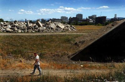 A man walks through a portion  of the proposed Kendall Yards development Monday that could someday be a neighborhood of  at least 2,600 residences.   (Brian Plonka / The Spokesman-Review)