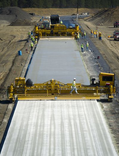 Crews lay concrete for a section of the North Spokane Corridor between U.S. Highway 395 and U.S. Highway 2 on Wednesday.  (Colin Mulvany)