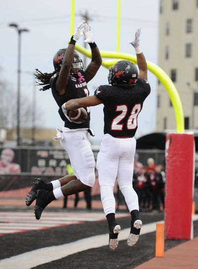 Eastern Washington back Antoine Custer Jr. (28) and wide receiver Jayson Williams  celebrate a touchdown against Portland State in the first half Saturday, Nov. 23, 2019, in Cheney. (James Snook / For The Spokesman-Review)