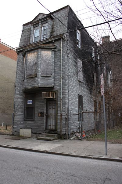 Here's an old inner-city house that might be a flipping candidate. It might also be better put into a landfill. (Tim Carter)