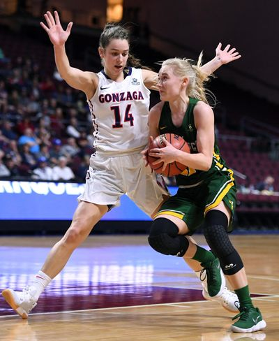 Gonzaga guard Emma Stach (14) defends San Francisco guard Anna Seilund (21) as she heads toward the basket during a West Coast Conference Basketball Championships women's semifinal game, Mon., March. 5, 2018, at Orleans Arena in Las Vegas. (Colin Mulvany / The Spokesman-Review)