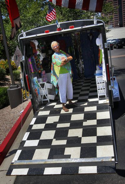 Julia Hutton stands inside her custom trailer in Phoenix. Hutton owns ExTreme ReTrailers, which designs custom trailers to look like mini stores on wheels. (Associated Press)