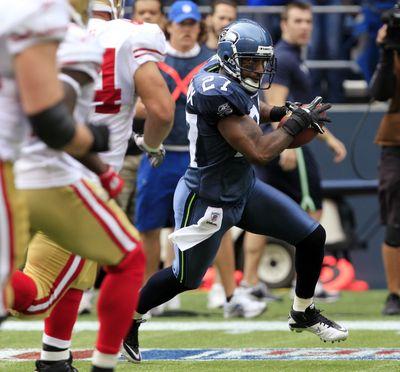 Seattle's Jordan Babineaux returns an interception of a pass by 49ers quarterback Alex Smith 20 yards in the first quarter. (Associated Press)