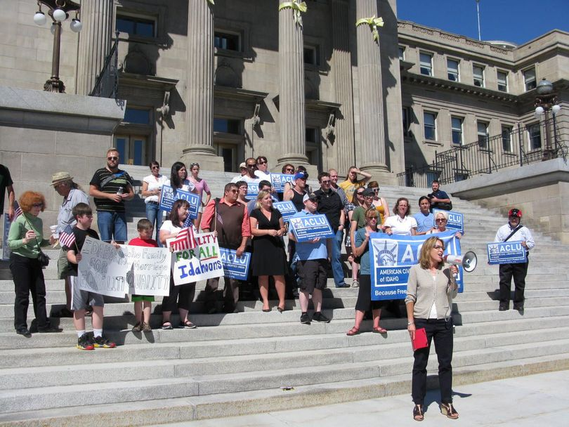 Kim Beswick addresses the crowd at a rally supporting the U.S. Supreme Court rulings on same-sex marriage, on the steps of Idaho's state Capitol on Wednesday afternoon. (Betsy Russell)