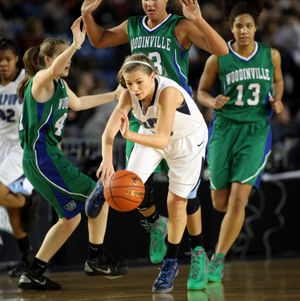 Gonzaga Prep's Laura Stockton, middle, blows through three Woodinville defenders during action in the 4A Girls State Basketball Tournament Thursday at the Tacoma Dome. (Patrick Hagerty / The Spokesman-Review)