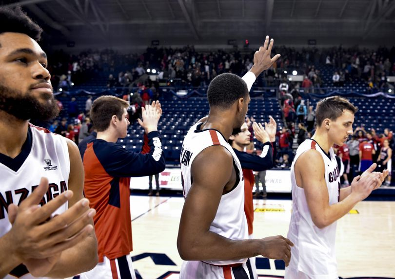 Gonzaga guard Eric McClellan (23) salutes the student section after a college basketball game on Tuesday, Dec 8, 2015, at McCarthey Athletic Center in Spokane, Wash. Gonzaga won the game 61-58. (Tyler Tjomsland / The Spokesman-Review)
