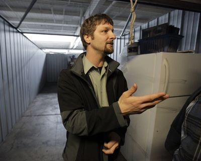 Brook Snyder auctions off property from a locker inside a storage facility in Chicago. The contents of storage units are being  sold as more people fail to keep up with monthly payments.  (Associated Press / The Spokesman-Review)