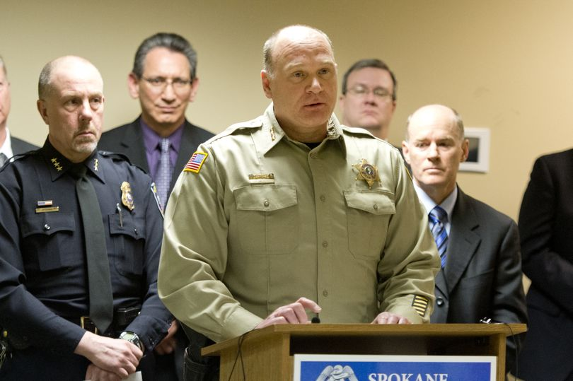 Spokane County Sheriff Ozzie Knezovich, center, talks to reporters, along with police Chief Frank Straub, left, and interim Special Agent in Charge W. Jay Abbott, right. (Jesse Tinsley)